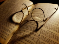 Glasses on bible Fuji X-10 by bill fortney